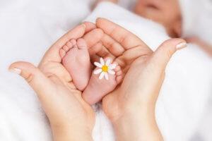 Как пособие положено при рождении ребенка